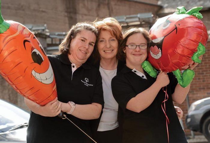 Lynn Conroy (left) and Carol Nairn (right) of the Special Olympics, with Minister of State Kathleen Lynch.